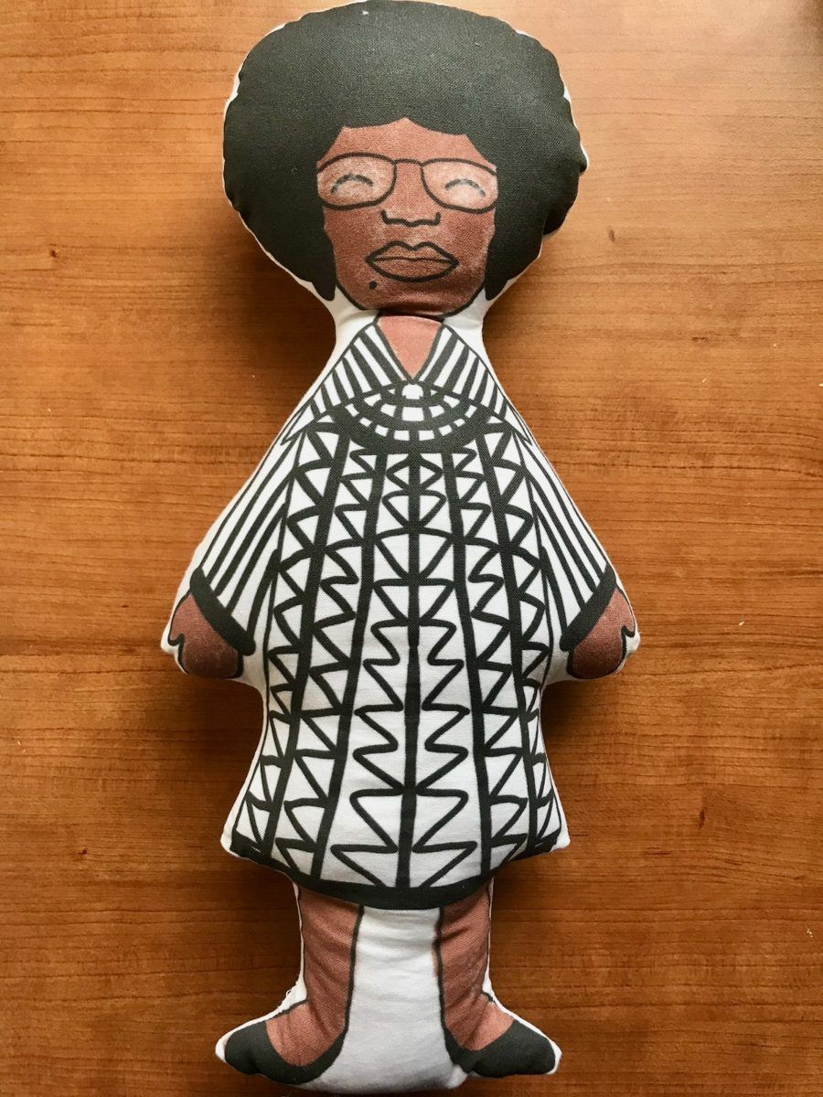 Historical education on the back of the Shirley Chisholm doll